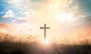 creating and observing sacred spaces; image of cross on meadow