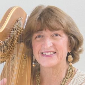 Barbara Lepke-Sims plays the harp in Denver
