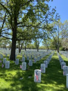 Creating and observing sacred spaces; image of tombstones at Fort Logan National Cemetery