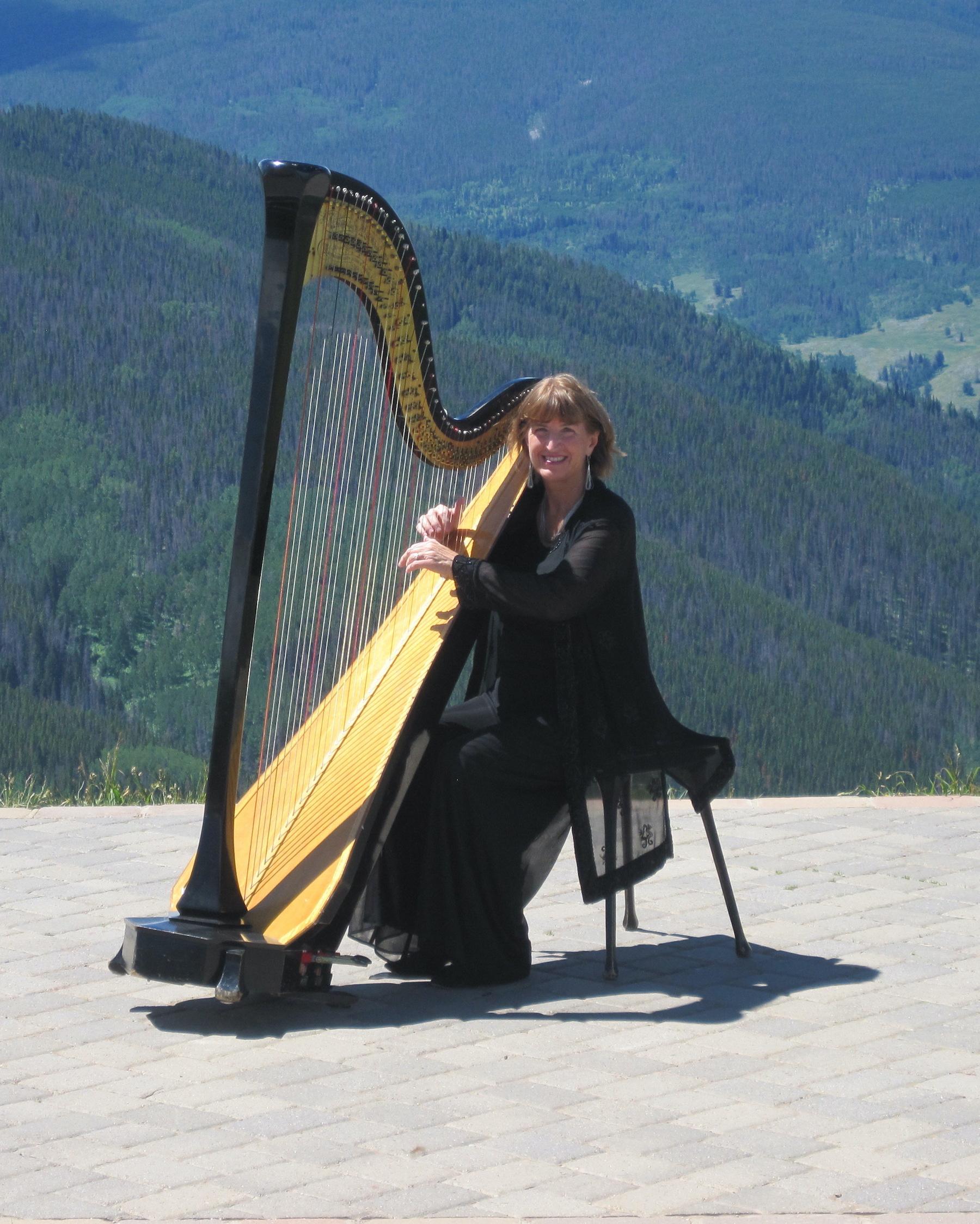 Barbara playing harp wedding music in Vail, Colorado.