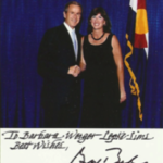 Barb the harpist playing for former President George W. Bush.