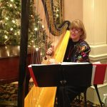 Barbara playing at the Denver Country Club holiday party.