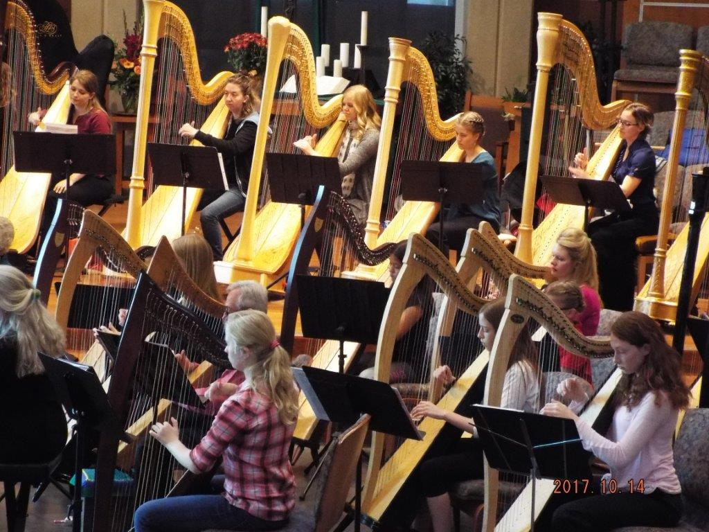 Barbara's students playing at the harp fantasia performance after taking harp lessons.