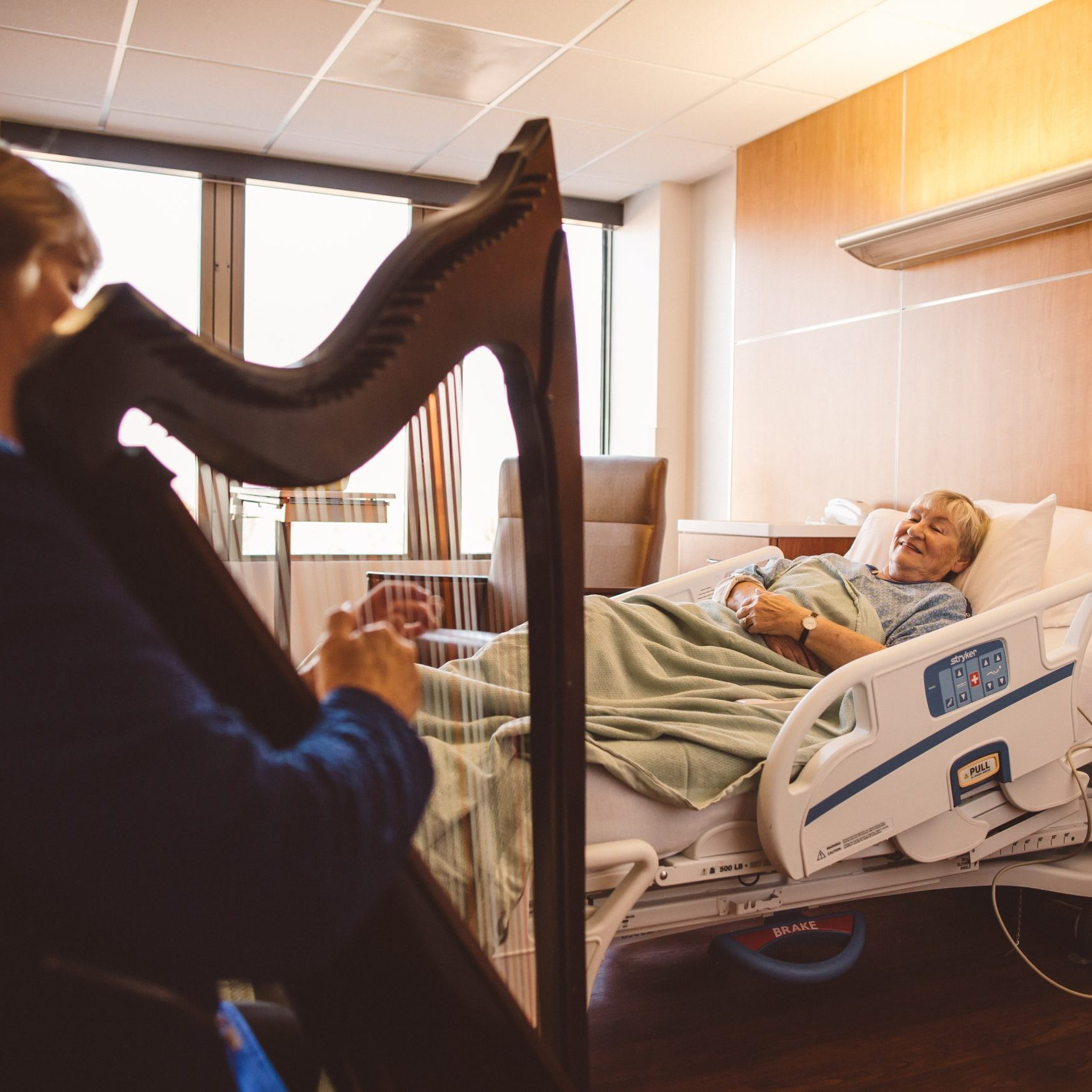Denver Harpist Barbara Playing Therapeutic Music for Patient